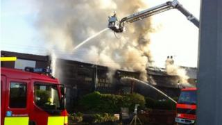 Firefighters tackling the fire