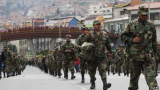 Air Force and Army soldiers march on the third day of protests in La Paz, Bolivia. 24 April 2014