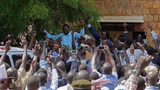 Oyai Deng Ajak (left) and Ezekiel Lol Gatkuoth leave court in Juba - 25 April 2014