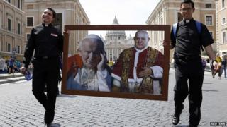 Priests carrying portraits of popes in Rome, 25 Apr 14