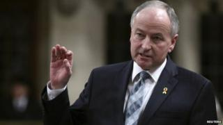 """Canada""""s Defence Minister Rob Nicholson speaks during Question Period in the House of Commons on Parliament Hill in Ottawa 3 March 2014"""