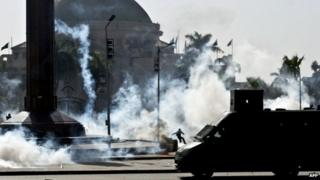 Tear gas fired by riot police during demonstration outside Cairo University. 26 March 2014