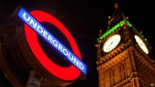 A London Underground sign in front of the Houses of Parliament