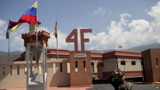A soldier stands guard at a former century-old military barracks where the late Hugo Chavez commanded a failed 1992 coup
