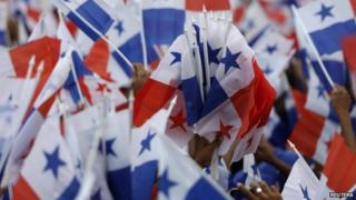 Supporters wave Panama flags at campaign rally in Panama City April 26, 2014