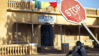 Malian soldier sits in a street in February 2013 in front of the offices of the Regional Assembly in central Gao, northern Mali