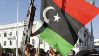 Libyan flag with gun at Green Square in Tripoli