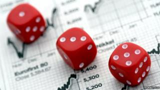 Three dice on stock market graphs