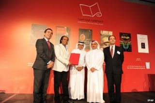 Ahmed Saadawi, second from left, received the prestigious prize in Abu Dhabi 29 April