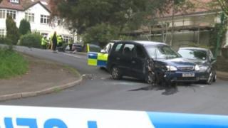 Police crash into blue Kia