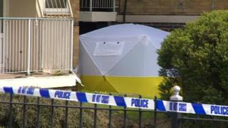 Police tent at scene of death