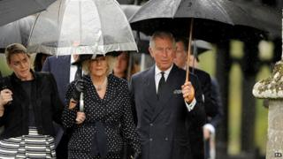 Prince of Wales, Duchess of Cornwall and her daughter Laura Lopes arrive for the funeral of Mark Shand at Holy Trinity Church in Stourpaine, Dorset, 1 May 2014.