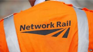 A Network Rail logo on the back of a hi-visibility jacket