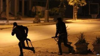 Libyan security forces are seen advancing during clashes with anti-government forces following an attack on a Benghazi police station, early on 2 May 2014