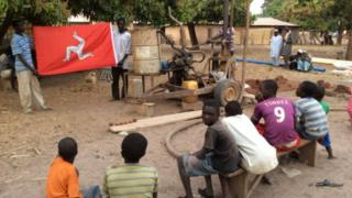 A new well being bored in a Gambian village
