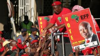 Julius Malema addresses supporters outside South African Broadcasting Corporation building in Johannesburg. 29 April 2014