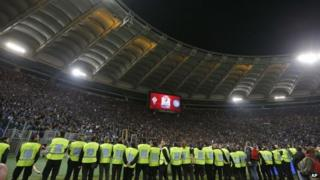 Fans wait for the start of the Italian football cup final, 3 May 2014