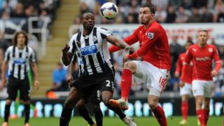 A Cardiff player and a Newcastle United player battle it out during a match at the weekend.