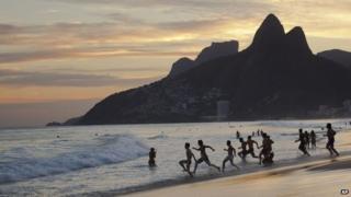 People running on a beach