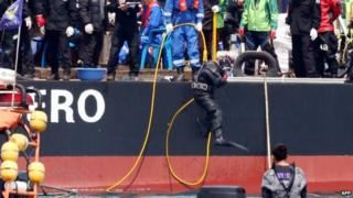 """A diver jumps into the sea to search missing passengers at the site of the sunken South Korean ferry """"Sewol"""" off Jindo on April 25, 2014."""