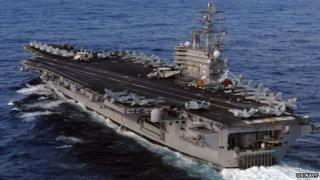A US Nimitz-class aircraft carrier in the Pacific Ocean