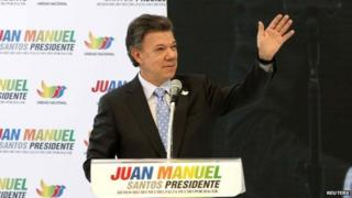 Colombia's President Juan Manuel Santos greets supporters during a campaign rally in Bogota on 28 April, 2014