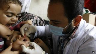 A Syrian child receives a polio vaccination
