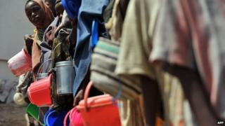 A file photo taken on 19 January 2012 shows displaced Somali children queuing as they wait for food-aid rations at a distribution centre in the capital, Mogadishu