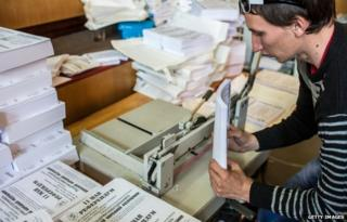 A man prepares ballots and flyers for a planned referendum seeking greater autonomy from the central government in Kiev, scheduled for May 11, in a building occupied by pro-Russian protesters on May 7, 2014 in Donetsk, Ukraine.