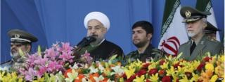 Hassan Rouhani (centre) on National Army Day in Tehran (18/04/14)