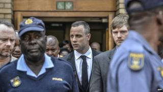 Oscar Pistorius leaves the courtroom in Pretoria - 5 May 2014