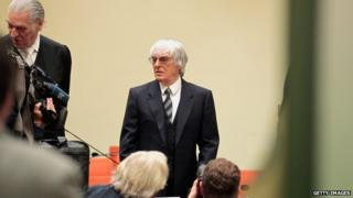 Bernie Ecclestone arrives for the third day of his trial for bribery on 9 May 2014