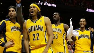 Players from the Indiana Pacers basketball team cheer during a playoff game on 1 May, 2014