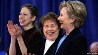 Hillary Clinton and her mother and daughter smile at an Iowa event in January 2008.
