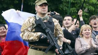 Armed pro-Russian activist at celebration of independence referendum in eastern Ukrainian city of Luhansk. 12 May 2014