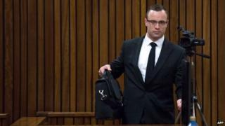 Oscar Pistorius arrives for his trial on charge of murdering his girlfriend Reeva Steenkamp, at the high court in Pretoria (13 May 2014)