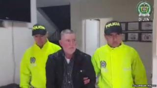 Manuel Salvador Ospina Cifuentes is escorted by police