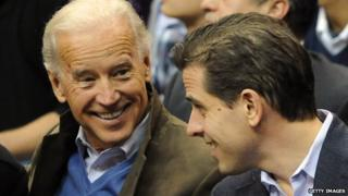 Joe Biden (left) talks with his son Hunter at basketball game in 2010.