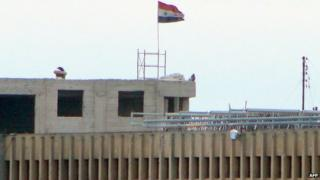 Syrian flag flies from Aleppo Central Prison (6 February 2014)