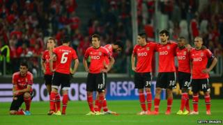 Benfica FC players line up during a penalty shoot-out.