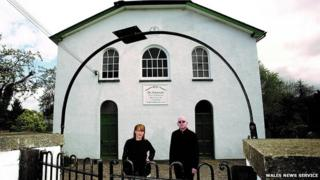 Alan Mcgee and Kat Holmes outside the former Baptist chapel in Talgarth, Powys