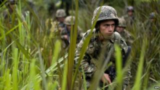 File photo: Colombian soldiers conduct a patrol across a field in a mountainous area in Miranda, Cauca department, Colombia, 18 January 2012