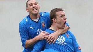 Les Davies of Bangor City celebrates scoring a goal