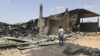Destroyed warehouses following clashes on Friday between Libyan irregular forces and Islamist militias in Benghazi (17 May 2014)