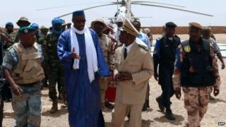 Mali's Prime minister Moussa Mara (centre) speaks to the prefect after arriving aboard a UN helicopter to Kidal, Mali 17 May 2014