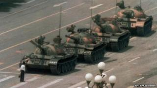A man stands in front of a tank in Tiananmen Square