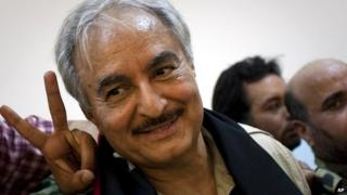 Khalifa Haftar leaves a news conference in Benghazi - 18 March 2011