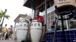 Pablo Gonzalez Portilla plays drums on a street in Miami's Little Havana neighbourhood