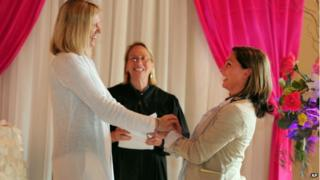 Julie Engbloom, left, and Laurie Brown, right, get married by Judge Beth A. Allen at the Melody Ballroo, in Portland, Oregon 19 May 2014