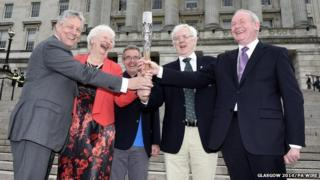 Queens Baton Relay of (left to right) Peter Robinson, Olympic champion Mary Peters, Chris Jenkins, Robert McVeigh and Martin McGuinness holding the Commonwealth Games Baton on the steps of Stormont, Belfast, Northern Ireland.